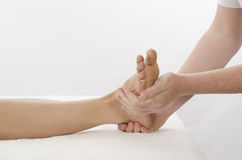Kinesiologist treating foot Peroneus Royalty Free Stock Photography