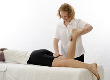 Kinesiologist treating Hamstrings Royalty Free Stock Photo