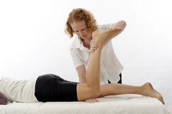 Kinesiologist treating Knee flexors Royalty Free Stock Photography