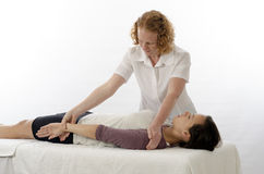 Kinesiologist treating Latissimus Dorsi. Kinesiologist or physiotherapist treating Latissimus Dorsi Stock Photo