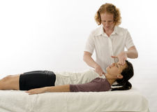 Kinesiologist treating neck muscles Royalty Free Stock Images