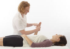 Kinesiologist treating opponens pollicis Royalty Free Stock Photography