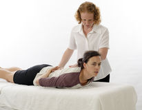 Kinesiologist treating Sacrospinalis Stock Photography