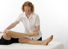 Kinesiologist treating Sartorius Royalty Free Stock Image