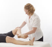 Kinesiologist treating Sartorius Stock Photo