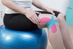 Kinesiology tapes on knee royalty free stock photo