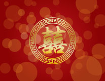 Kinesisk bröllopdubblettlycka på röd bakgrund Royaltyfria Foton