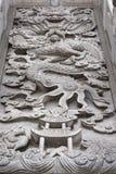 Kinesisk drake - vita marmorlättnader Arkivbilder