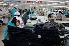kinesisk fabrikssvett arkivbild