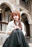 kinesisk flicka förlorad tanke Arkivbild