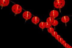 Kinesisk garnering för nytt år--Röda lyktor blänker på, bokeh arkivbilder