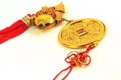 Kinesisk guld- amulett Arkivbilder