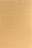 Kinesisk guld- siden- bakgrund Arkivfoton