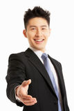 Kinesisk hand för affärsmanReachingTo Shake Royaltyfri Bild