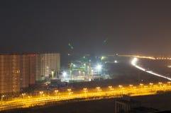 Kinesisk konstruktionsplats på natten Arkivbilder
