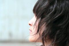 kinesisk lockig flickahårsida Arkivbilder
