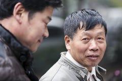 Kinesisk manstående i Hangzhou arkivbild