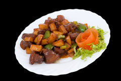 kinesisk mat stekte porkpotatisar arkivbild