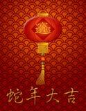 Kinesisk ormlykta för nytt år på röd bakgrund Fotografering för Bildbyråer