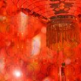 Kinesisk röd lykta som är upplyst på natten Fotografering för Bildbyråer