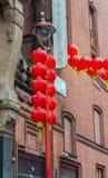 Kinesiska garneringar för nytt år, kineskvarter London UK Arkivfoton