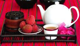kinesiska litchees ställde in tea Arkivfoton