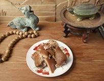 Kinesiska matgrisköttskal med antikviteten arkivbild