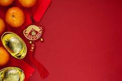 Kinesiska mynt av lycka eller kinesiska kinesiska guldtackor för fnuren och Arkivfoto