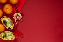 Kinesiska mynt av lycka eller kinesiska kinesiska guldtackor för fnuren och Royaltyfria Bilder