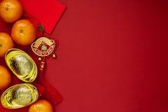 Kinesiska mynt av lycka eller kinesiska kinesiska guldtackor för fnuren och Royaltyfri Fotografi