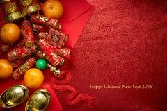 Kinesiska mynt av lycka eller kinesiska kinesiska guldtackor för fnuren och Arkivbild