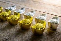 Kinesiska pengar av lycka och guld- pengar för kines och den traditionella chien Arkivbild