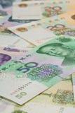 Kinesiska sedlar, kinesiska pengar, kinesiska dollar för backgro Arkivbild