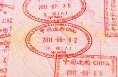 Kinesiska visumstämplar i passet Royaltyfri Fotografi