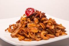 Kinesiskt kött - Halogenbrosk Arkivbild
