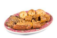 Kinesiskt kokt griskött med champinjoner, havsgurkan och hård kokt äggkokkonst Royaltyfria Bilder