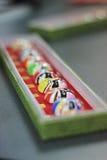 Kinesiskt konstverk: Målade maskeringar Arkivfoto