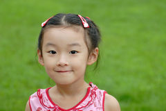 kinesiskt leende för barn royaltyfria bilder