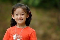 kinesiskt leende för barn arkivfoton
