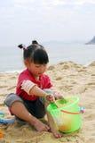 kinesiskt leka för strandbarn Arkivfoto