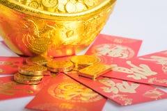 Kinesiskt nytt år guld- mynt Arkivfoto
