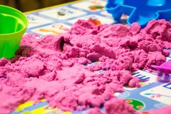 Kinetic pink sand. In a heap for indoor game or children creativity forms for the construction Stock Images