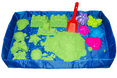 Kinetic sand in a mobile sandbox Stock Photos