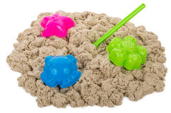 Kinetic sand with molds. Close-up kinetic sand with molds, isolated on white Royalty Free Stock Photos