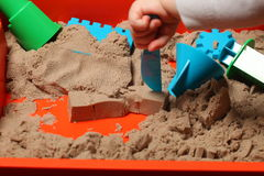 Kinetic sand play baby Stock Image