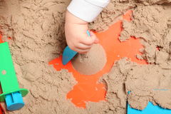 Kinetic sand play baby Royalty Free Stock Image