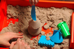 Kinetic sand play baby Royalty Free Stock Images