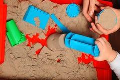 Kinetic sand play baby Stock Photography