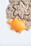 Kinetic sand and toys. On white background Royalty Free Stock Image