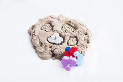 Kinetic sand. On white background Stock Photos